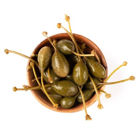 Capers isolated on white with clipping path as package design element. Capers is used to flavor dishes and go well with meat, to fish, to pasta. Full depth of field.