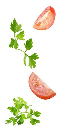 floating parsley and tomatoes isolated on white background 写真素材