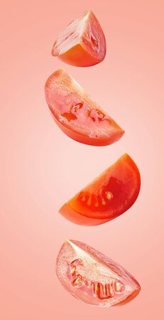 Flying vegetables. Falling tomato isolated on colored background   as package design element and advertising. full depth of field Banco de Imagens