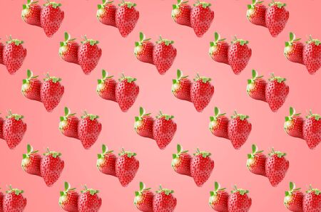 Seamless minimal summer fruits pattern of many whole strawberries on coral texture, for blog or recipe book. Horizontal orientation.