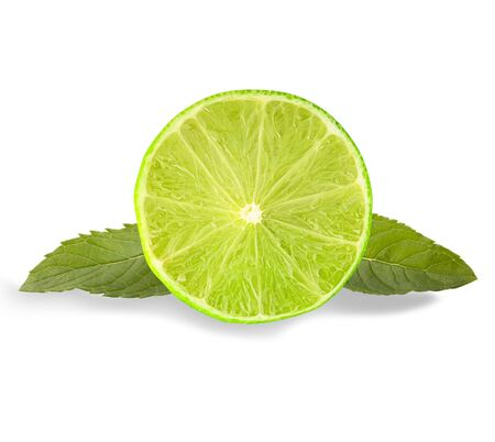 Isolated fruits. Lime slice and mint leaves isolated on the white background  as package design element and advertising. Professional studio macro shooting.