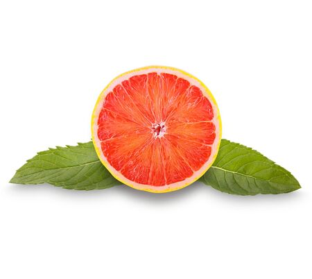 Isolated fruits. Grapefruit slice and mint leaves isolated on the white background   as package design element and advertising. Professional studio macro shooting.
