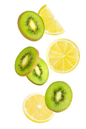 Flying kiwi. Floating slice of lemon and kiwi fruits isolated on white background with as package design element and advertising. Full depth of field. Zdjęcie Seryjne