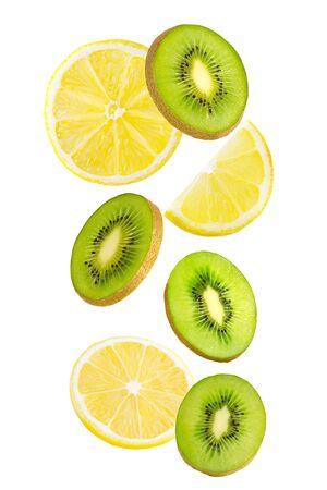 Falling kiwi and lemon fruits isolated on white background.