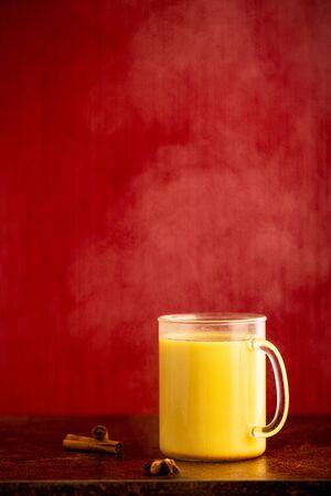 Turmeric latte, healthy hipster drink. Ayurvedic drink, alternative medicine. Zdjęcie Seryjne - 141066633