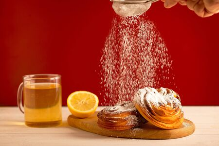 Cup of kombucha tea with pastry desserts on the neutral background. Healthy and unhealthy breakfast concept Zdjęcie Seryjne