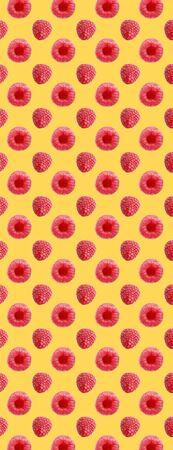Seamless pattern food. Fresh raspberry fruits on yellow background. Zdjęcie Seryjne
