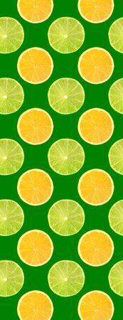 Creative seamless pattern food. Fresh slice of orange and lime fruits on green background. Full depth of field. Zdjęcie Seryjne