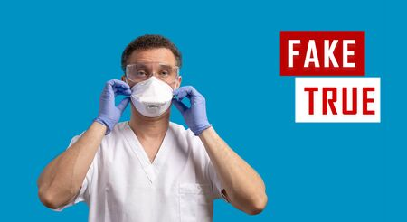 Corona virus fake news concept. Man wearing with protective mask, glasses and blue latex gloves. Social media disinformation. Banner with copy space. Zdjęcie Seryjne
