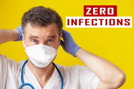 Banner with Doctor that taking off medical mask for absence of coronavirus infections on yellow background, with text. Zero Infection of other people concept. Zdjęcie Seryjne