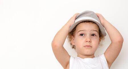 Happy boy in straw hat over white background