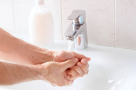 Washing hands rubbing with soap for corona virus prevention