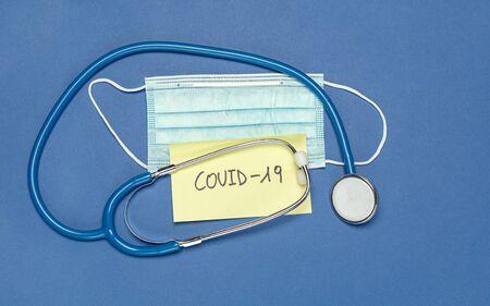 Minimalist layout coronavirus symbols and text on blue background
