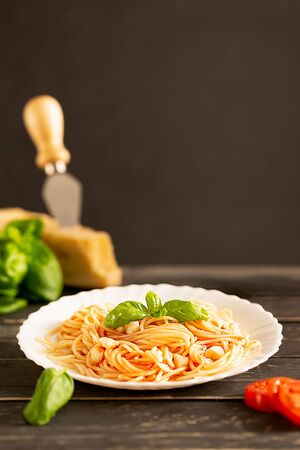 Spaghetti with tomato sauce and fresh basil