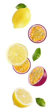 Falling maracuja and lemon isolated on white background with shallow depth of field Zdjęcie Seryjne