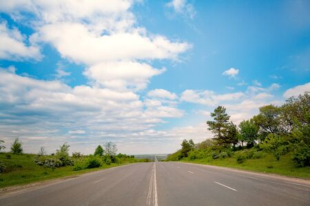 Road panorama on sunny day. Concept of travel, adventure and the road along success.