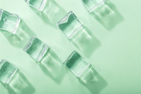 Colored banner with fresh ice cubes and reflections