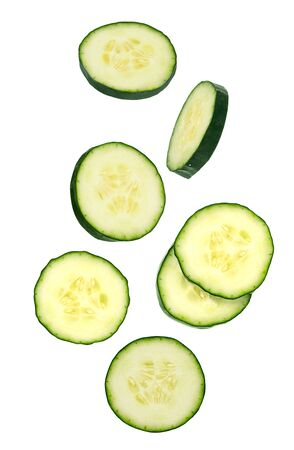 Flying vegetables. Seven slice of cucumbers isolated on white for packaging design and advertising. full depth of field. Clipping path included. Archivio Fotografico