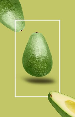 Avicado isolated on green background with shallow depth of field