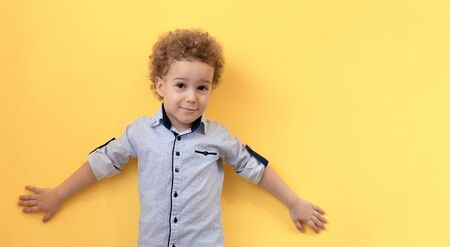 Portrait of boy with raised hands up