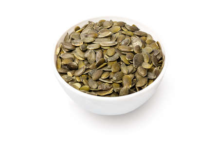 Bowl with pumpkin seeds isolated on white background Archivio Fotografico