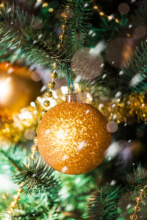 Christmas decorations on the branches fir with sparkles Archivio Fotografico