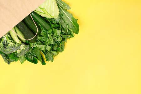 Food vegetable in eco grocery bag on yellow background Zdjęcie Seryjne