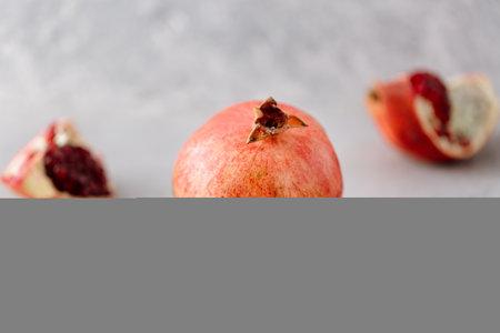 Piece of fresh pomegranate fruit on neutral background Archivio Fotografico - 160597284