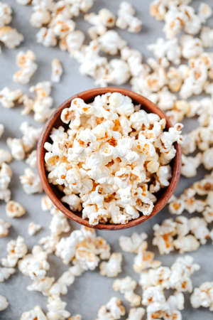 Homemade popcorn in a wooden bowl on a grey background Archivio Fotografico - 161048360