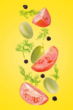 Creative flying fresh ingredients for salad on trendy coloured background Archivio Fotografico