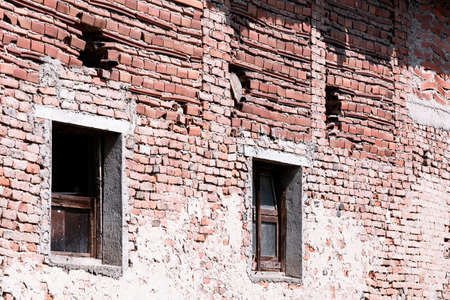 Outdoor ruined brown brick wall fragment with windows Archivio Fotografico