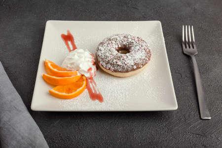 doughnut on plate isolated on black background Archivio Fotografico