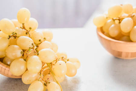 white grapes in a basket on a table