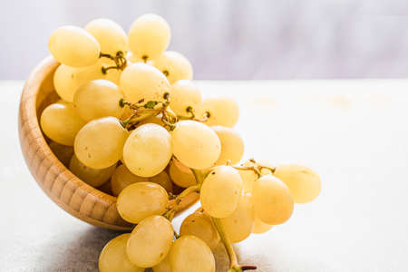 white grapes in a bowl on a table