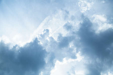 closeup of blue sky background with tiny clouds