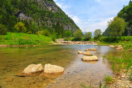 Stream with its refreshing water between the mountain peaks Archivio Fotografico