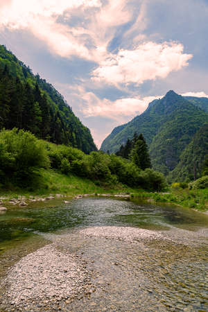Stream with its refreshing water between the mountain peaks