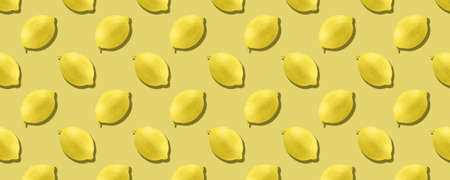 Whole lemon fruit pattern on yellow color background