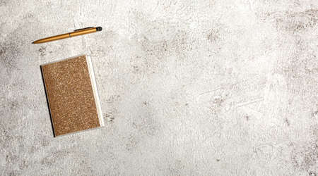 Mockup with notebook isolated on concrete background