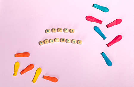 Flatlay of colorful balloons with text happy birthday Archivio Fotografico