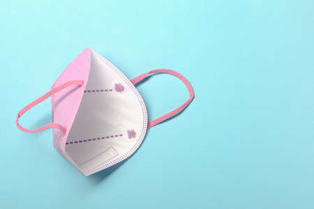 Creative minimal flat lay layer with KN95 or N95 FFP2 mask for protection pm 2.5