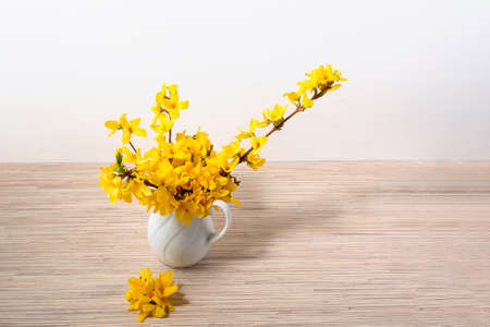 Yellow flower bouquet in vase on table with copy space Archivio Fotografico