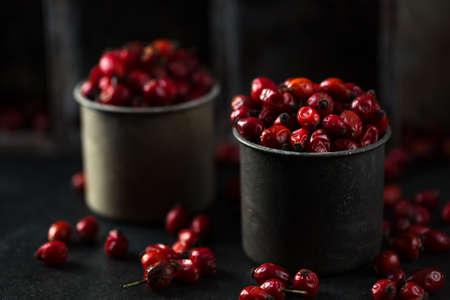 Gooseberry Rose fruits in dark mood on trendy background