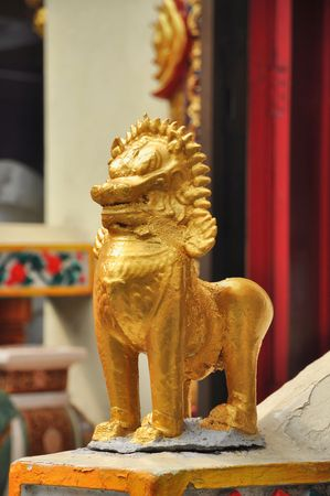 objectivity: Gold Asia Lion Stand Doll
