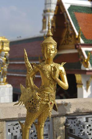 Gold Sculpture Man Bird Thailand photo