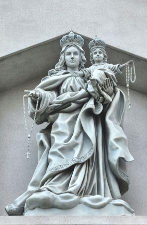 objectivity: Madonna Christ Cement Monument Stock Photo