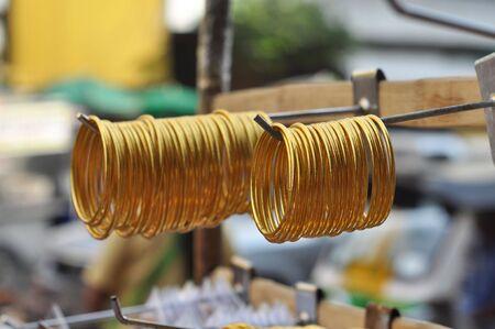 correlate: Many Gold Bangle Set Stock Photo