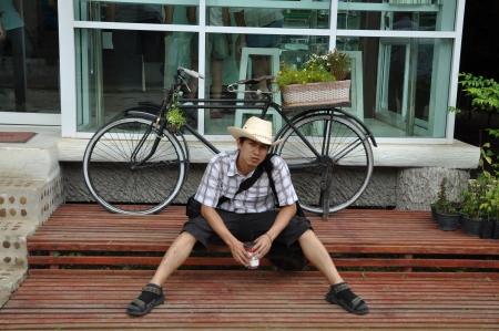 Asia Thailand Man Cowboy Sit Stock Photo
