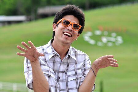 Asia Thailand Man Orange Sunglasses Crazy Smile photo