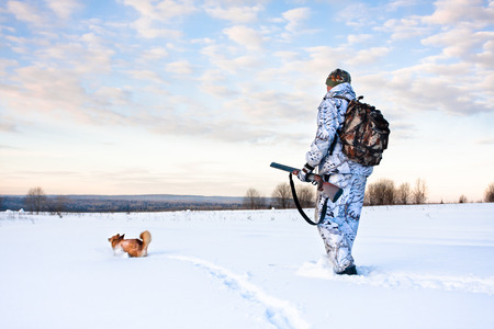hunter: hunter on the skis on winter hunting